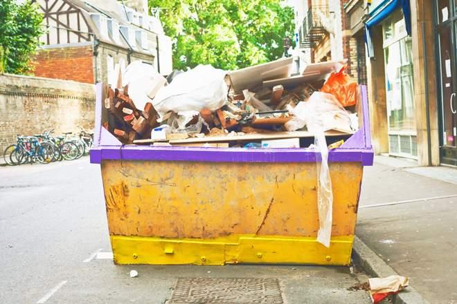 вывоз мусора бункером